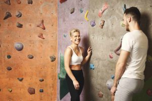 couple meeting at rock climbing gym