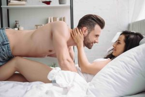 couple in bed man with no shirt on